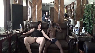 Tisha takes some black cock as her hubby watches and films