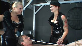 Chubby dominatrix with nice big tits torturing a stranger