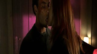 Natasha Henstridge making out with a guy in a bathroom as