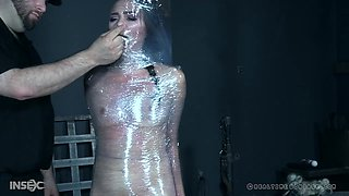 Slender brunette babe Alex More wrapped in plastic and abused hardcore