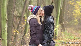 Lesbians in love kissing in forest