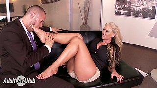 Hot like hell blond bitch Phoenix Marie presents steamy foot job to hungry boss
